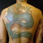 Dragon tattoos by Commitment tattoo St. Pete, FL